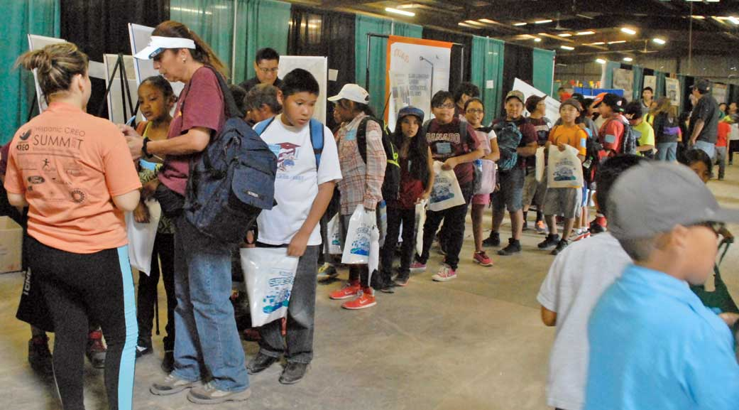 Free backpacks a hit during Kids Day giveaway