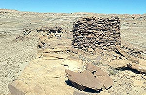 Small ruins like this watchtower, outliers of the civilization that built the great houses of Chaco Canyon, dot White Rock Chapter and make it hard to get archeological clearances for development. (Times photo — Cindy Yurth)