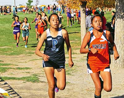 Gallup girls keep a pack to the finish line, place first at KC meet