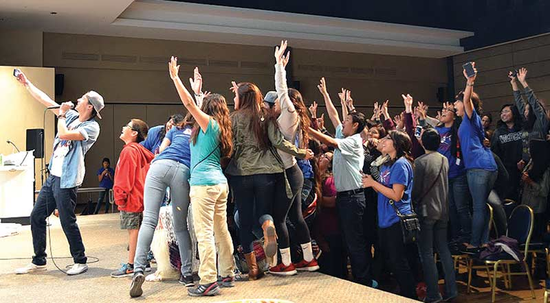 Concert-goers rush the stage as Waln snaps a selfie after the show on Saturday night. Fans stayed on the University of Arizona campus late into the night to meet the rapper. (Courtesy photo)