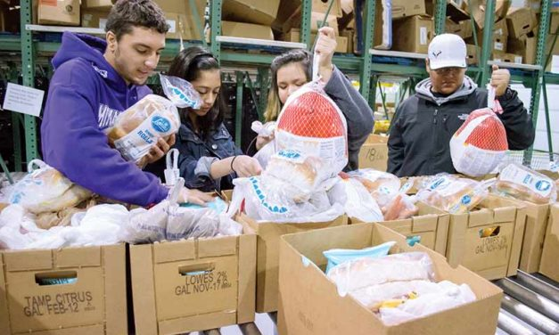Gallup Rotary Club hands out 100 food baskets