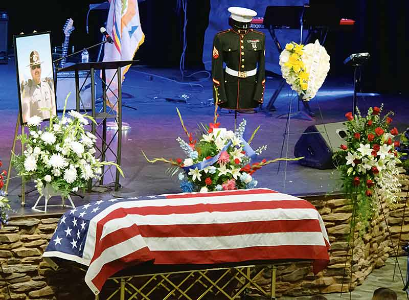 A flag covers the casket of fallen Navajo police officer Alex Yazzie on Friday at the Pinon Hills Community Church in Farmington. Yazzie was shot and killed in the line of duty on the night of March 19. (Times photo - Donovan Quintero)