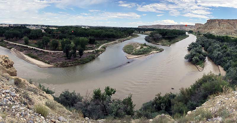 A clearer Animas River, left, joins the San Juan River last Monday in Farmington, N.M. Despite a clearer appearance, Navajo tribal officials continue to caution community members living along the San Juan River to not drink it, swim in it or let their livestock drink it until further notice. (Times photo - Donovan Quintero)