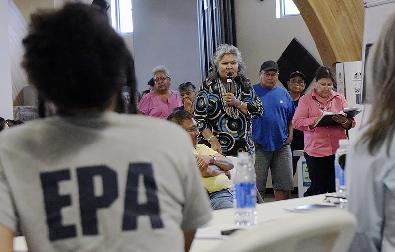 Upper Fruitland farmer Lenora Williams expresses her frustrations to EPA remedial project manager Zi Zi Angelica Searles about the problem the office she represents caused Saturday night during a meeting at the Nenahnezad Chapter. (Times photo - Donovan Quintero)