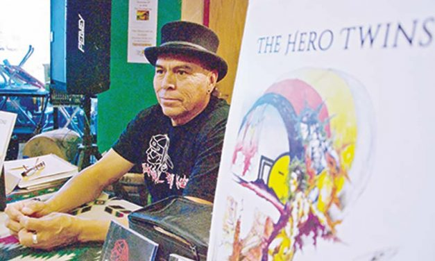 Artist paints pictures for book to preserve Diné bizaad