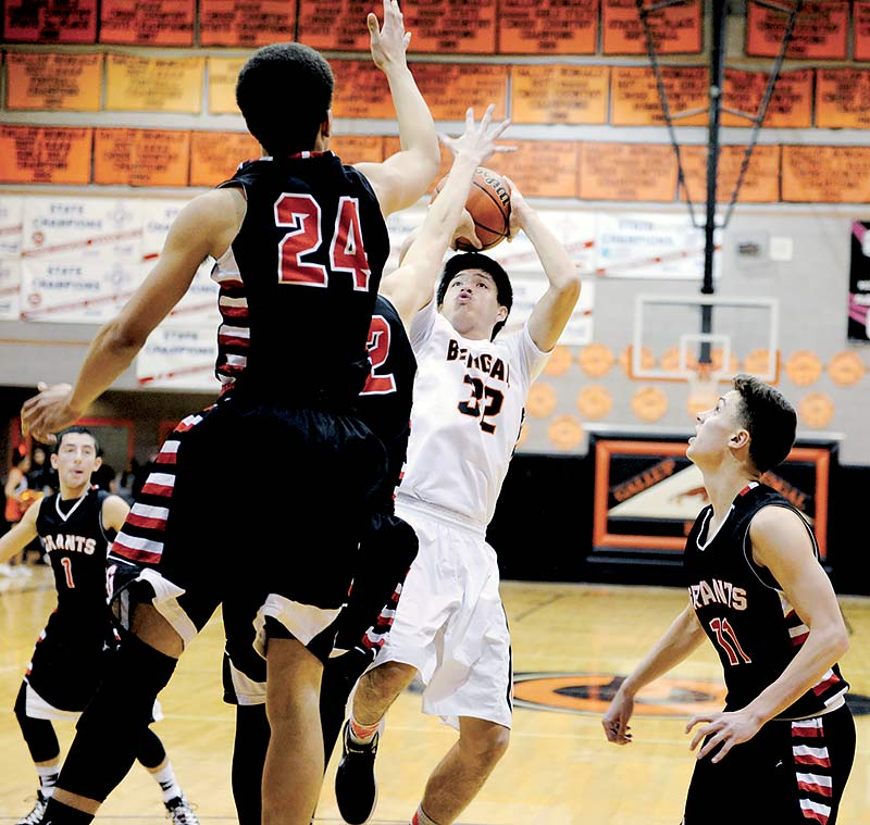 Navajo Times | Paul Natonabah Gallup Bengal Colton Lowley (32) puts up a short jumper over the Grants Pirates during their championship drive at the 72nd annual Gallup Invitational on Saturday. Gallup won 78-72 in overtime.