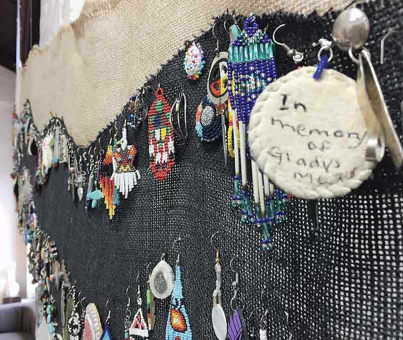 Special to the Times | JayDiamond Taliman An earring at the Durango Arts Center pays mute tribute to a victim of abuse.