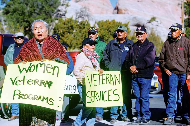 Navajo Times | Adron Gardner Katherine Benally speaks about shortcomings in veterans' care during a veterans march to the Office of the President and Vice President in Window Rock on Nov. 18.