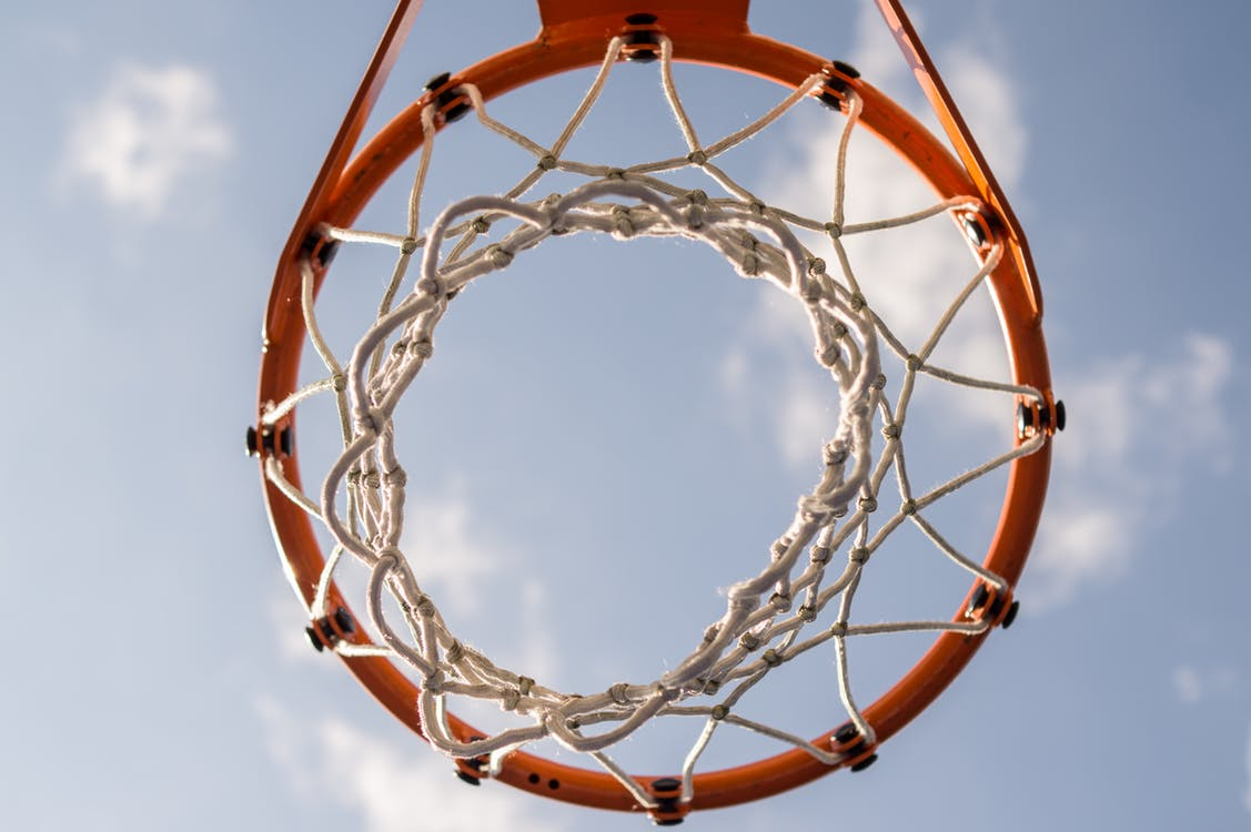 Basketball hoop through sky.