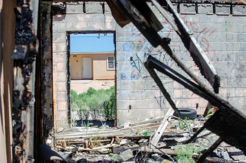 Abandoned houses in Fort Defiance create eyesore, danger