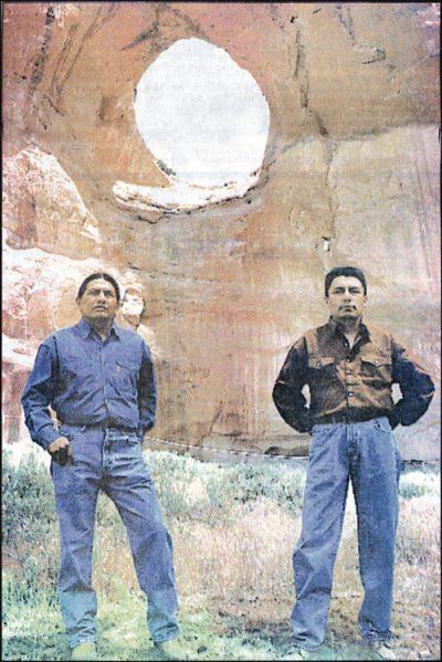 Guys standing in front of Window Rock.