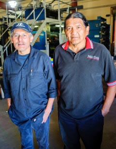 Willie Holtsoi and Lawrence Curley in the press room of the Navajo Times in July 2017.