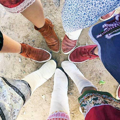 Feet pointing together in a circle