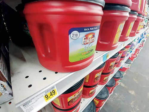 plastic folgers coffee containers on store shelf with 9.49 price sticker