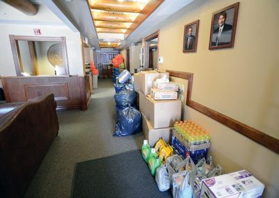 Bags and boxes line the president's office hallway