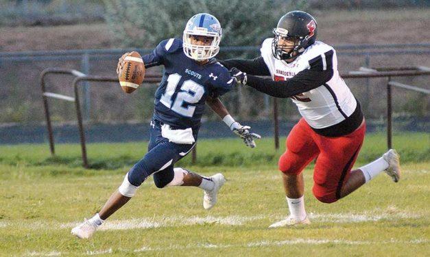 Page quarterback runs wild over Scouts