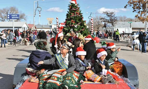 Snow grounds balloons, parade spreads holiday cheer