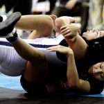 Wrestler overcomes injury, wins state girls' title