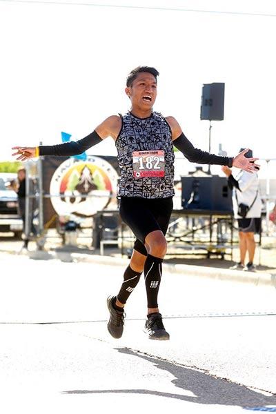 runner skips across finish line
