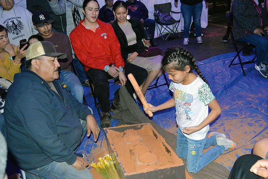 A sense of home: 10th annual shoe game brings songs, laughter to urban Navajos