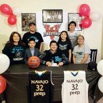 Navajo Prep grad signs with ACU