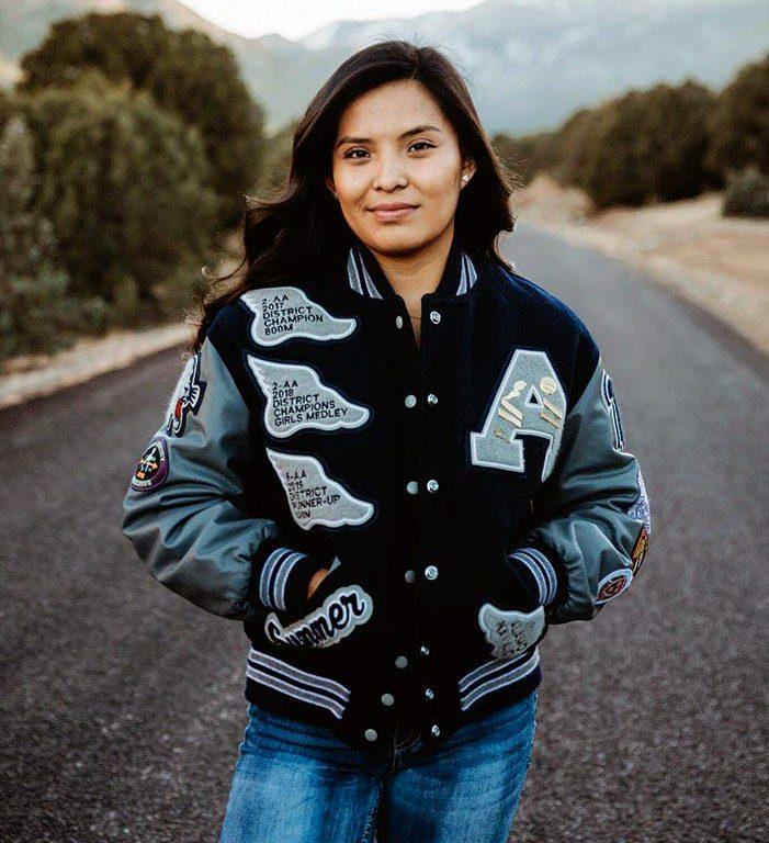 Bye bye, birdie:  Alamo Navajo grad trades the greens for Navy blue