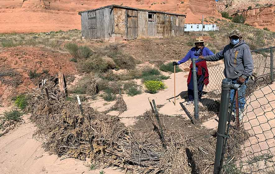 Brush dams save home from flood, pile up soil