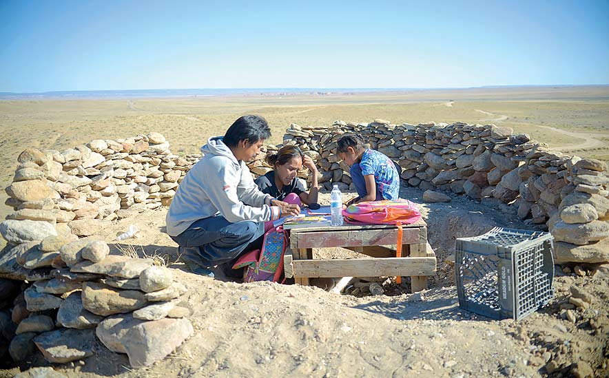 Hill becomes makeshift classroom for a Fish Point family