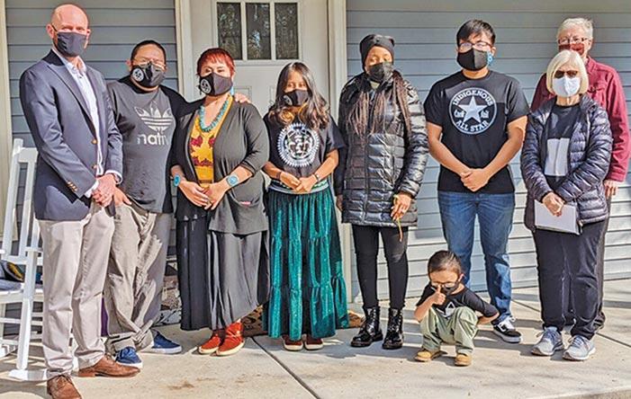 Harrison family dedicates new Habitat for Humanity home