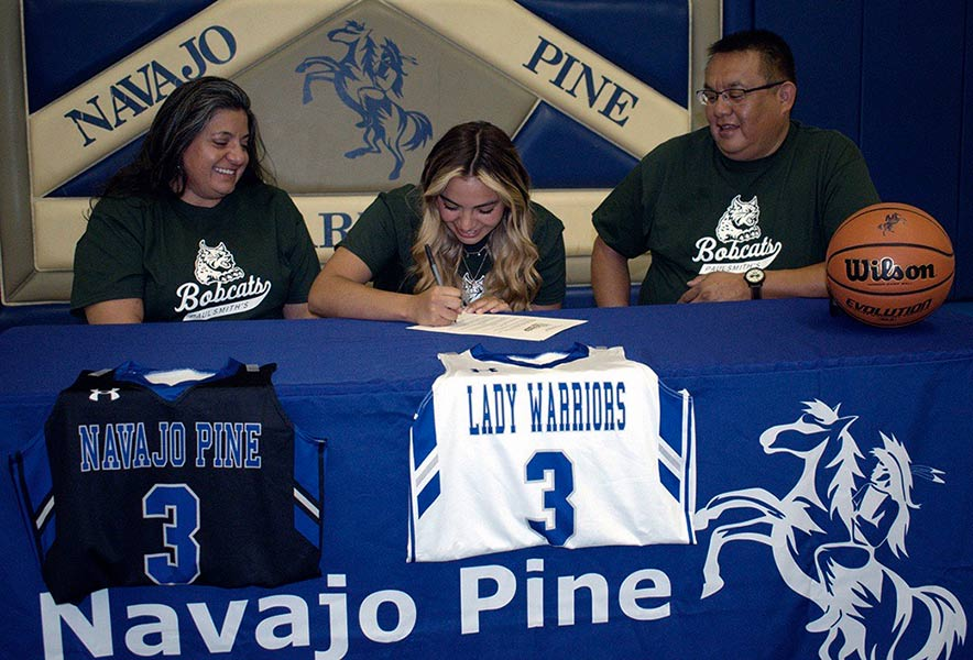 Navajo Pine standout signs with New York college
