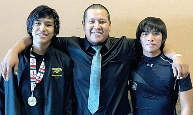 Newcomb Skyhawk makes histor: Junior wins first-ever state wrestling title, fulfills dream