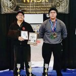After year of pandemic, Diné father, son roar back to powerlifting