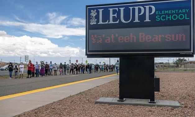 Dozens of fans greet man walking in bear suit